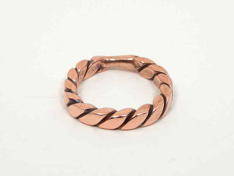 This copper ring took many steps to make: first I annealed and twisted the wire, then hammered it square, bent the ring into shape, cut the wire, ...